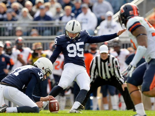 Penn State place kicker Tyler Davis kicks a field goal during the second half of Saturday's 39-0 win against Illinois at Beaver Stadium.