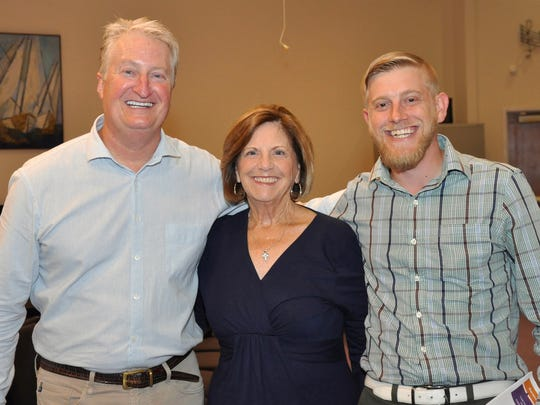 """Andy Andrews poses with Karen Dominik and her son, Nathan, following Andrews' presentation to the Bonita Christian Forum Nov. 14. Nathan has said Andrews' book """"The Noticer"""" changed the course of his life."""