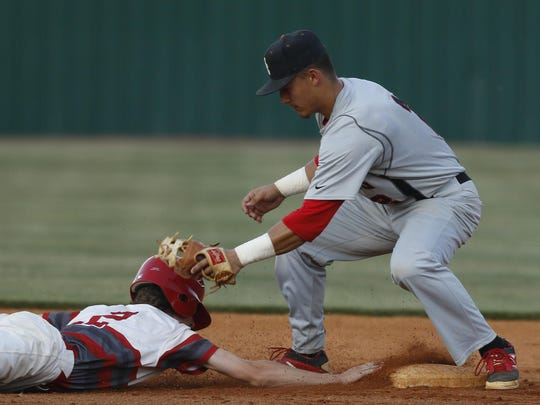 Stewarts Creek shortstop Tre Bailliez puts the tag on an Ooltewah baserunner during Friday's Class AAA sectional, won by the Red Hawks 6-4 in 10 innings.