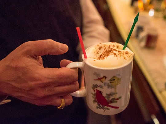 A warm Tom and Jerry cocktail is made on a busy Friday night at the Brass Rail Bar in downtown Port Huron, Nov. 24. The bar has been serving the seasonal drink for decades.