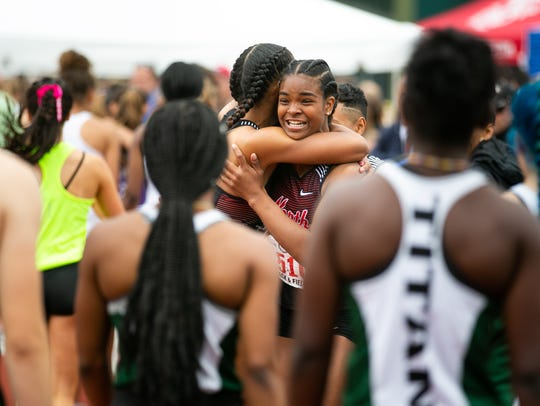 North Salem's Nerissa Thompson, facing, embraces Maliyah