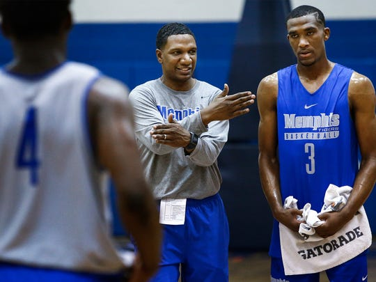 University of Memphis assistant coach Pooh Williamson (middle) directs guard Jeremiah Martin (right) during an open practice at the Larry O. Finch Center.