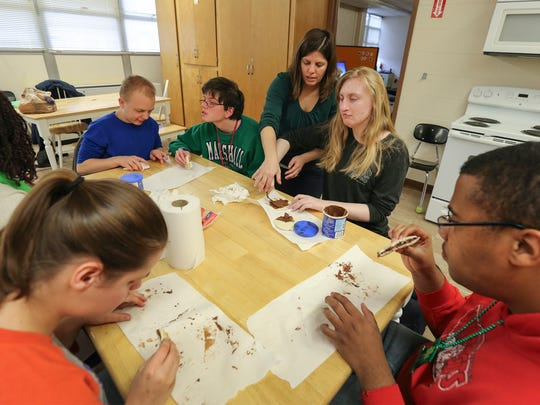 Jennifer Stocker helps students at the Kentucky School for the Blind during a practical living class at the school.March 17, 2017