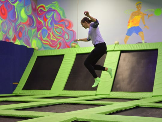 Rachel Behr, 22, of Westland, jumps at Zap Zone in