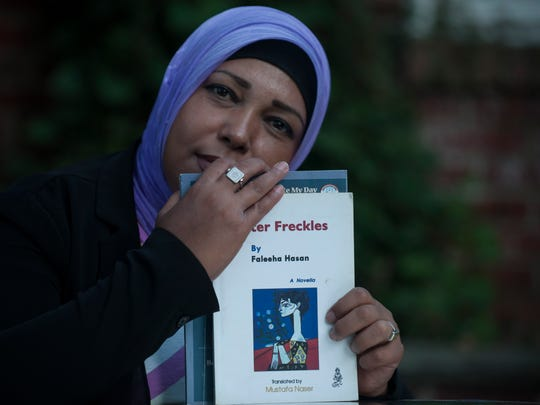 Poet  Faleeha Hassan  pose for a photo with her poetry books in Haddonfield. Faleeha Hassan, known as the Maya Angelou of Iraq, is one of the most widely published women in Iraq. Her work has been translated into many languages.