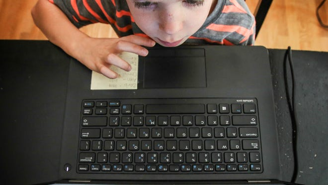 Marcus McLean, 5, works on a web-based instructional program at his home in New Albany.  Floyd County schools were the first in Indiana to pilot an online preschool program called UPSTART last year.