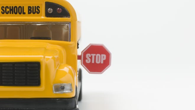 Toy bus with stop sign