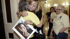 In this Sept. 9, 2015, file photo, Debbie Ziegler holds