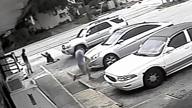 In this July 19, 2018 file image taken from surveillance video released by the Pinellas County Sheriff's Office, Markeis McGlockton, far left, is shot by Michael Drejka during an altercation in the parking lot of a convenience store in Clearwater. Drejka, who told detectives that he was irritated by people who illegally park in handicapped spots was convicted of manslaughter in the fatal shooting of McGlockton, an unarmed black man outside a convenience store.