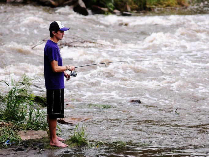 Matthew Horan, 21, of Sioux Falls, fishes in Skunk Creek, which flows into the Big Sioux River, on Wednesday, June 11, 2014, near Legacy Park in Sioux Falls. Water quality in the Big Sioux River drainage is affected by more than 200 small to medium-sized livestock operations between Sioux Falls and Brookings.  Federal funding to help producers improve livestock facilities and management practices  is shrinking. Brad Johnson, chairman of the South Dakota Board of Water and Natural Resources, says without such funding water quality will decline.