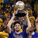 Golden State Warriors guard Klay Thompson (11) hoists the trophy after game seven of the Western conference finals of the NBA Playoffs against the Oklahoma City Thunder at Oracle Arena. The Warriors defeated the Thunder 96-88.