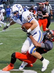 Somerville's Timothy Ciempola (22) tackles Cranford's Jake Bradford (29) in Somerville on September 8, 2017. (Photo by Keith Muccilli, Correspondent)