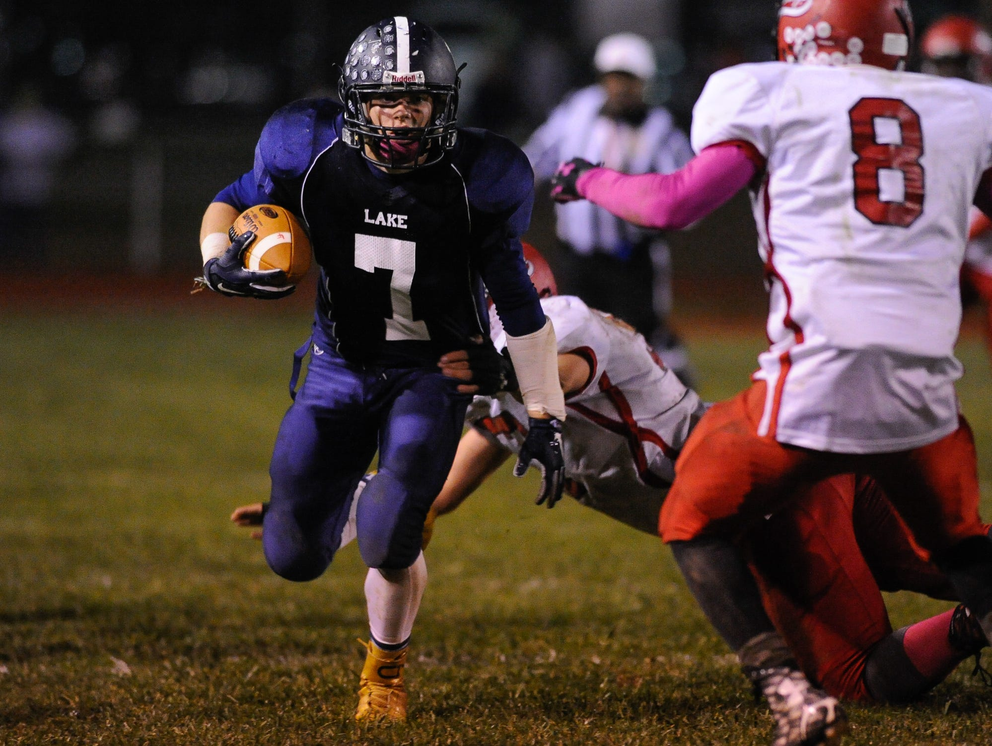 Lake Forest's #7 Benjamin Moore breaks a tackle near the side line in their home game against Laurel.