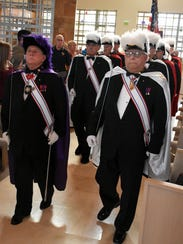 Knights of Columbus lead the procession to the altar.