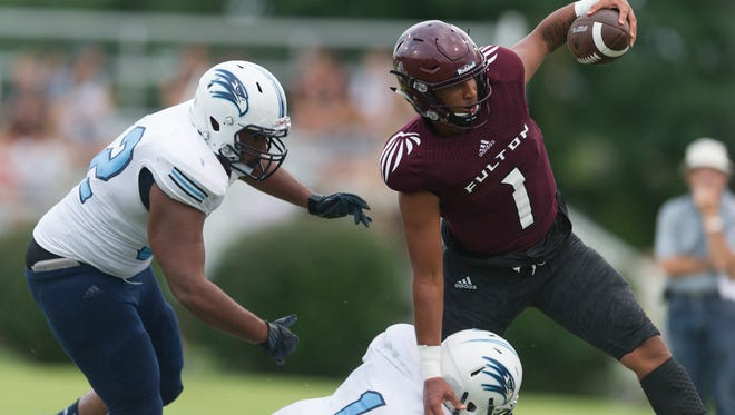 Fulton's Xavier Malone (1) evades Hardin Valley's Cameron York (1) and Keenan Sloan (52) during the annual KOC Kickoff Classic at West High School in Knoxville, Tennessee on Friday, August 11, 2017.