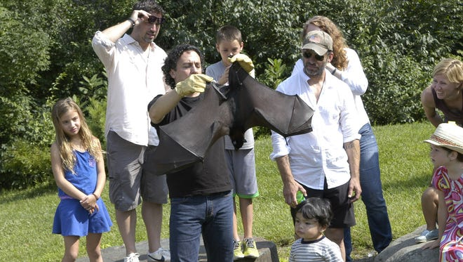 """""""Batman v. Superman: Dawn of Justice"""" director Zack Snyder (in baseball cap) and some members of the film's crew visited the Bat Zone at the Crabrook Institute of Science in Bloomfield Hills, Mich."""