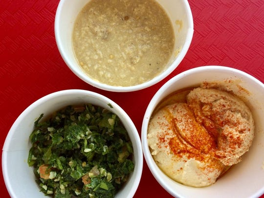 Trio of sides, clockwise from left: tabouleh, baba