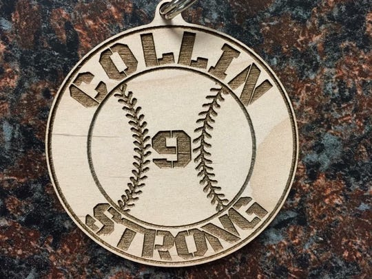 A 'Collin Strong' keychain in support of Phoenix Horizon