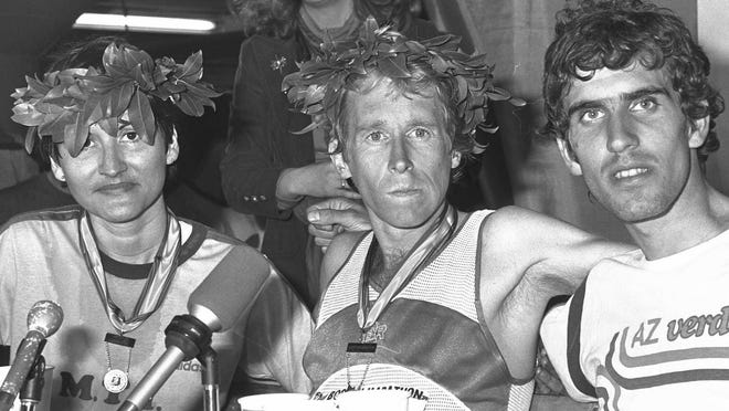 Bill Rodgers, center, of Sherborn, Mass., winner of the Boston Marathon, Rosie Ruiz, left, of New York, winner of women's division, and Italy's Marco Marchei, right, who finished second, 500 yards behind Rodgers, during a news conference in Boston on Monday, April 21, 1980.   AP file photo.
