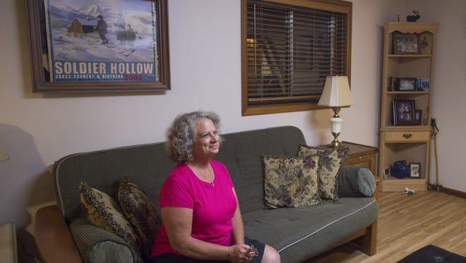 Marilyn Fox poses for a portrait in the vacation rental at her Fort Collins home. Fox hopes an exception is made to new city regulations will keep her rental in operation.