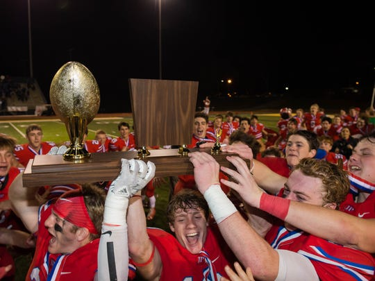 Jackson Prep players hoist the trophy following their win over Parklane in the MAIS Division 1 Championship Friday, November 17th, 2017 in Clinton, MS.(Bob Smith-For the Clarion Ledger)