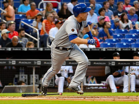 New York Mets third baseman Todd Frazier (21) connects for a base hit in the second inning against the Miami Marlins during a MLB game at Marlins Park.
