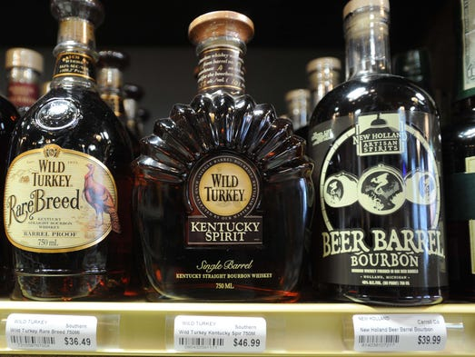 """Big Red Liquorshas started a liquor store war, since moving into the Indianapolis market in a big way in March 2013 by purchasing 24 United Package Liquor stores. In April, the chain also bought <a href=""""http://www.indystar.com/story/entertainment/dining/2014/04/15/kahns-closes-downtown-location/7739039/"""">Kahn's Fine Wines & Spirits'</a>Downtown location. Here is a detail of the """"Bourbon Wall"""" in the Downtown store."""