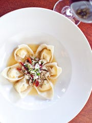 "The Sonoma Goat Cheese Ravioli is a ""wow"" dish, with garlic, white wine, basil, sweet tomatoes and truffle oil."
