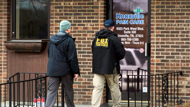 FBI agents enter the Knoxville Pain Care clinic Tuesday, March 10, 2015.