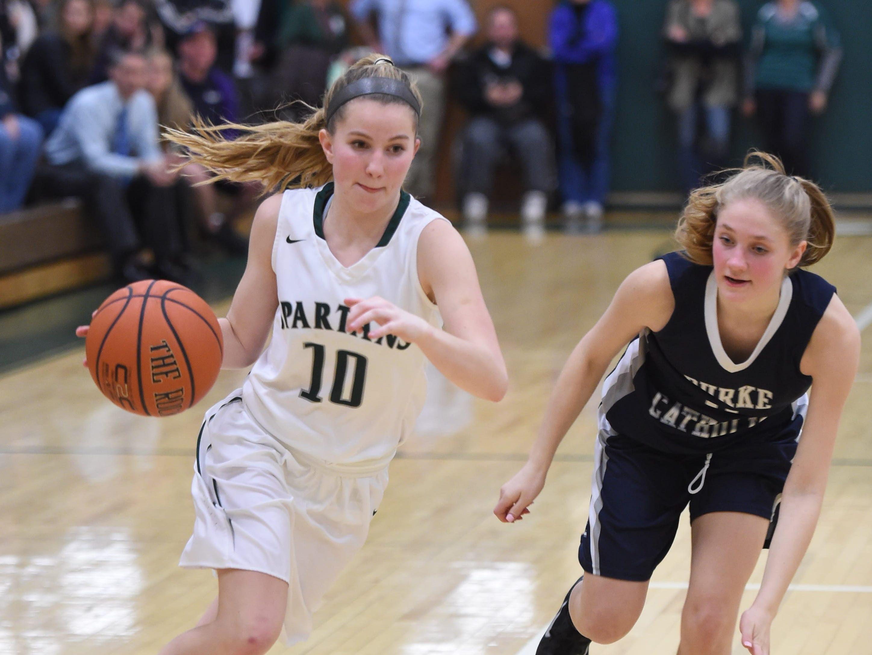 Spackenkill's Katherine Lillis dribbles past Burke's Mary Costa during Friday's Section 9 Class B semi-final at Spackenkill.