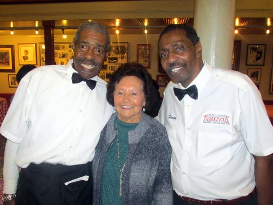 From left, Big Robert Stewart, Tasia Vergos and Percy Norris at the Rendezvous reception.