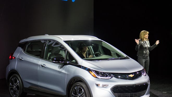 Automakers are responding to the push to cut carbon emissions with not-yet-profitable alt-energy vehicles such as Chevrolet's Bolt.