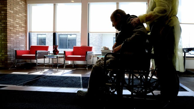 Michigan should modify a system in which nursing home residents infected with the coronavirus can be treated and isolated in those facilities and take steps to improve life for all long-term care residents amid the pandemic, a task force urged Gov. Gretchen Whitmer in a report released Tuesday.