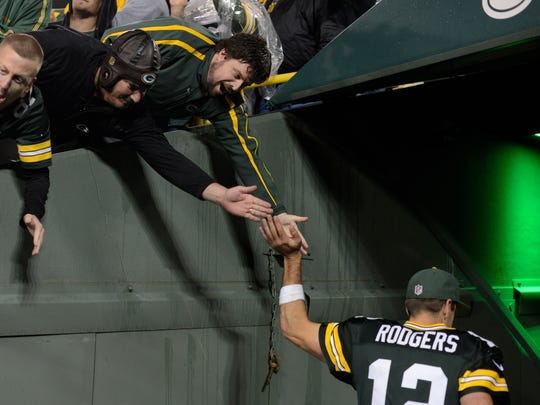 Aaron Rodgers walks into the tunnel following a Packers