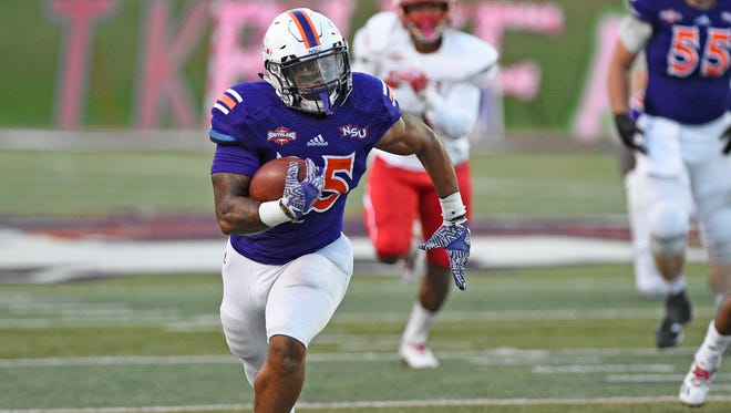 Northwestern State's De'Mard Llorens runs against the Nicholls State defense.