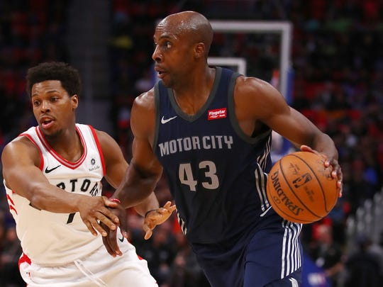 Anthony Tolliver #43 of the Detroit Pistons drives around Kyle Lowry #7 of the Toronto Raptors during the first half at Little Caesars Arena on April 9, 2018 in Detroit, Michigan.