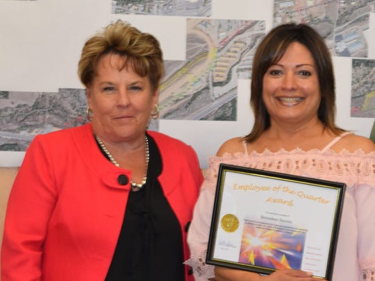 Ruidoso Village Manager Deni Left, left, presented the employee of the quarter award to Bernadeen Herrera for administration at the Ruidoso Convention Center.