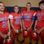 Union City High School football players Jaydan Baker, left, Jordan Stuckey, Bailey Hughes and Tyler Thornhill.
