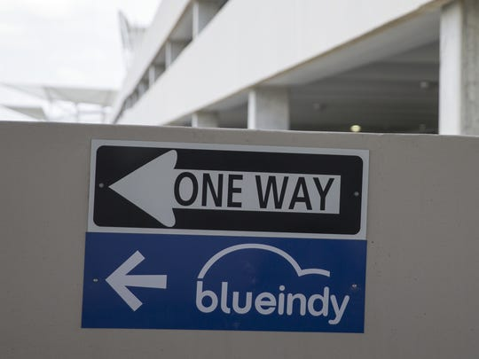 Signage directs cars to the BlueIndy charging stations, almost done, on the fifth floor of the parking garage at Indianapolis International Airport.