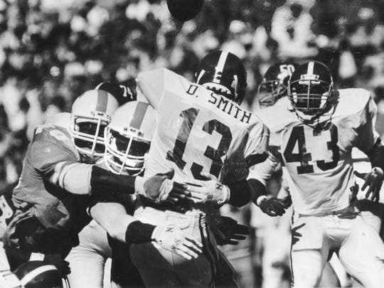 Alabama's David Smith gets crunched as he releases the ball on October 15, 1988 during the during the Tennessee-Alabama game.
