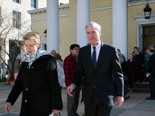 Special Counsel Robert Mueller, and his wife Ann, leave