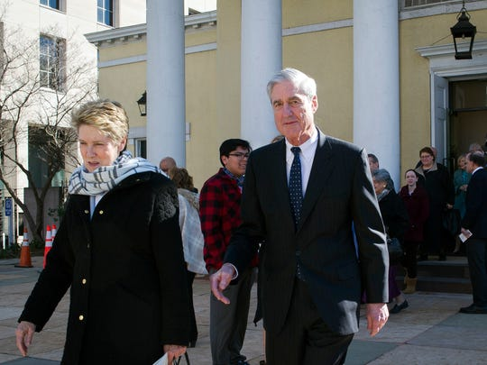 Special Counsel Robert Mueller, and his wife Ann, leave St. John's Episcopal Church, across from the White House, after attending morning services, in Washington.