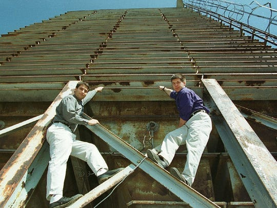 Architects Alex Halpern and Tom Weber of Freeman French Freeman, Inc. pictured before the Pease Grain Tower's demolition in 2000. The architects designed plans to convert the grain tower on the Burlington waterfront to a rock climbing building.