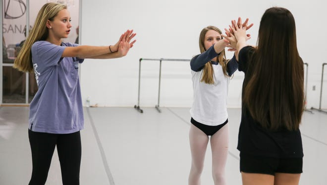 "Madi Rea, left, directs Julianna Elliott and Morgan Hulsey during rehearsal of her original piece Friday, May 5, at the Stephens Performing Art Center. Madi's piece will be showcased in ""Director's Choice — Intros."""