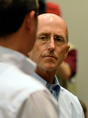 Mark Mayfield, the vice chairman of the Mississippi Tea Party, was arrested in connection with the photographing of Sen. Thad Cochran's bedridden wife. Mayfield listens to his attorney John Reeves during his initial court appearance in Madison, Miss., on Thursday, May 22, 2014.