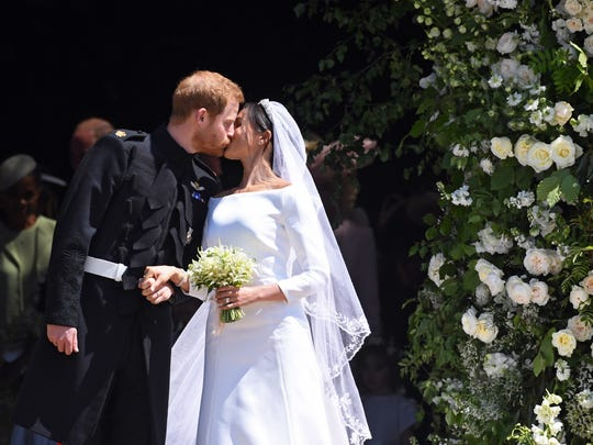 Prince Harry, Duke of Sussex, and Meghan, Duchess of Sussex, kiss as they exit St George's Chapel in Windsor Castle after their royal wedding on May 19, 2018.