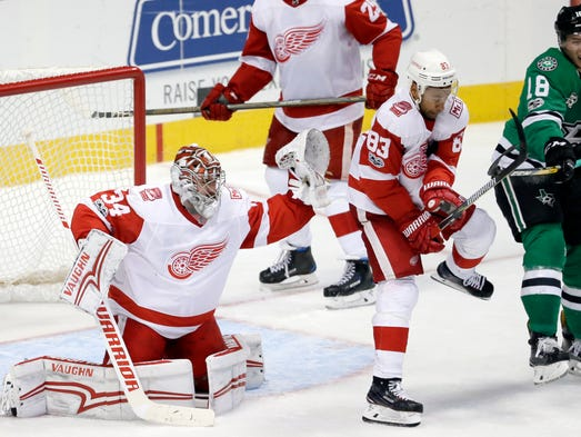 Red Wings goalie Petr Mrazek reaches up to defend against