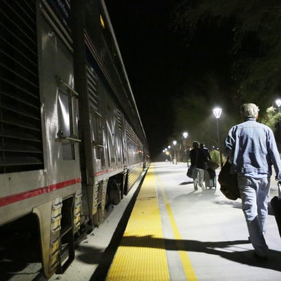 Passengers board the eastbound Amtrak Sunset Limited