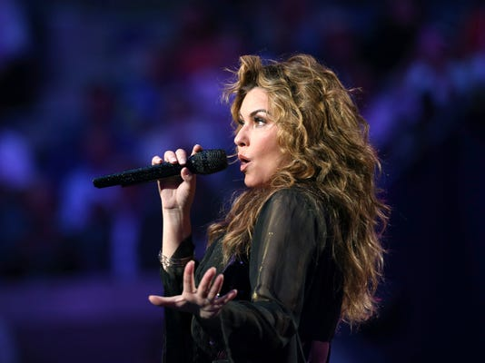 Shania Twain performs during opening ceremonies for the U.S. Open tennis tournament in New York, Monday, Aug. 28, 2017. (AP Photo/Kathy Willens)