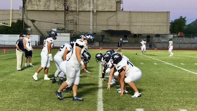 Willow Canyon football team practicing drills during pregame warm up at Sunnyslope high school in Phoenix, Arizona.